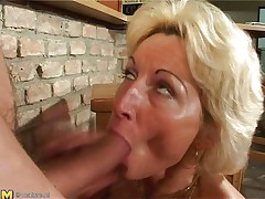 Stefana is a blonde mature bitch that loves to sucks cocks every time she can. Now she has in her mouth a long cock that she sucks it very nice while she sitting on her knees. The younger guy is ready now to penetrate her deep so he begins fucking her pussy from behind making Stefana screaming of pleasure.